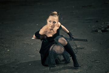 sexy young woman with katana sword