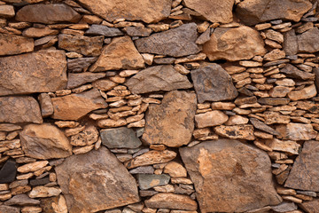 Fuerteventura, dry stone wall of local red rock