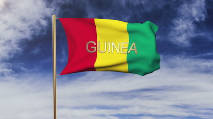 Guinea flag with title waving in the wind. Looping sun rises