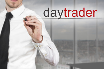 businessman writing daytrader in the air
