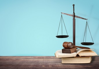 Law. Golden scales of justice, gavel and books isolated on white