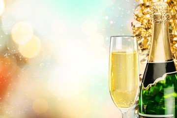Win. Flutes of champagne in holiday setting