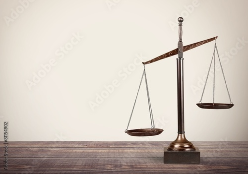 Leinwanddruck Bild Lawyer. Law scales on table in front black background. Symbol of