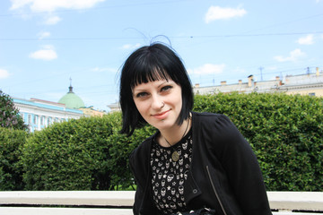 Portreit of pretty girl on Peterburg embankment