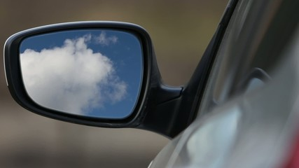 Rear view mirror reflecting sky