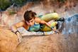 Leinwanddruck Bild - Rock climber climbing up a cliff