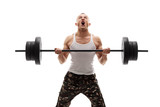 Determined young bodybuilder lifting a heavy barbell poster