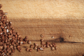 Grains of buckwheat on the wooden board