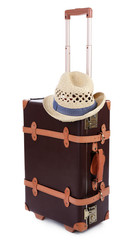 Suitcase and straw hat isolated on white