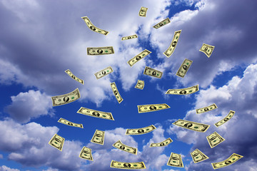 dollar banknotes flying away in the sky