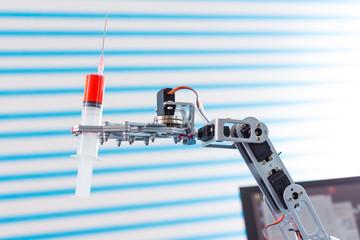 medical syringe in robot arm