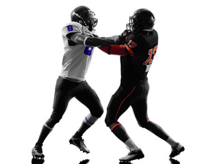 two american football players on scrimmage holding silhouette