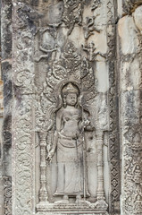 the beautiful ancient carving on the stone at Angkor wat