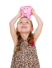 happy girl looking to the piggy bank on her head
