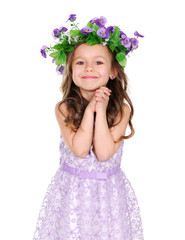 little girl wearing flower headband isolated on white
