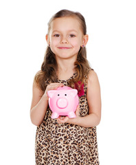 smiling girl holding piggy bank in hands