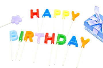 """candle """"Happy Birthday"""" with gift box on white"""
