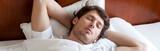 Fototapety Man sleeping in bed