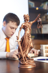 Justice statue and lawyer