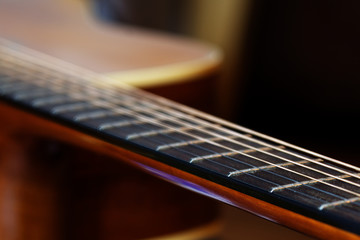guitar fretboard, detail with shallow depth of field
