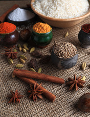 Rice and spices. Burlap background