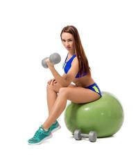 Cute female athlete exercising with dumbbells
