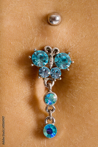 female navel with piercing - 81164947