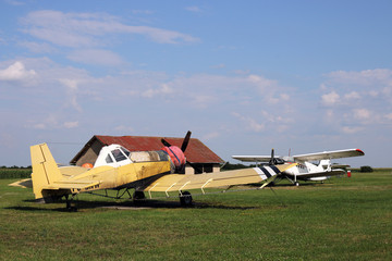 crop duster airplanes on airfield