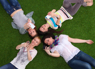 Group of young people having fun in Grass