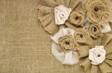 fabric flowers close up on a background of burlap