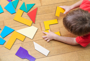 little boy playing with puzzle, early education