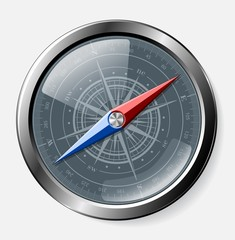 Steel detailed compass over grey background.