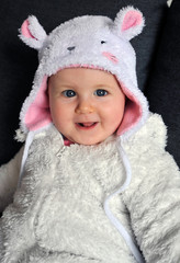 Little baby girl wearing a cute hat with ears