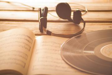 Headphones on music scores vinyl record music background