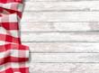 Leinwandbild Motiv kitchen table background with red picnic cloth