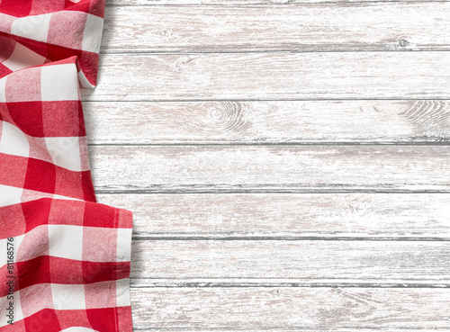Fotobehang Picknick kitchen table background with red picnic cloth