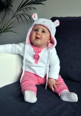 Little baby girl wearing a cute hat with ears