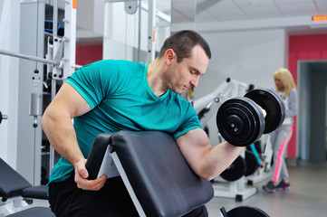 Exercises for the biceps with dumbbells