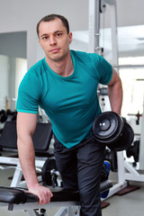 Image of fitness guy in gym exercising with dumbbells