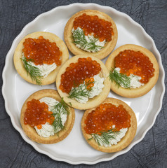 Tartlets with red caviar and cream cheese