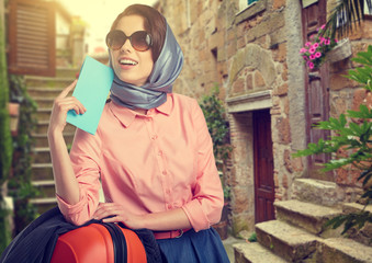 Elegant woman with a suitcase travel and ticket on street of ita