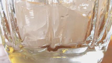 Orange Softdrink in a Glass Full of Ice