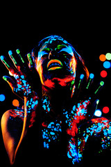 Girl with neon paint bodyart portrait, studio shot