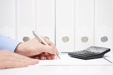 businessman is inspecting financial numbers in contract