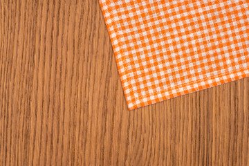 Rustic wooden boards with a orange checkered tablecloth