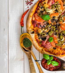 Pizza with ham and olives