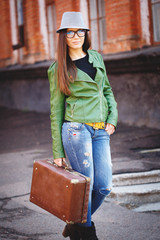 Portrait of a beautiful adult sensual woman with suitcase.