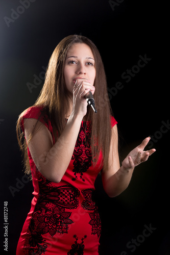 Young female singer in red dress Poster