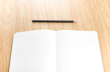 blank open notebook with black pencil on wood table,Business tem