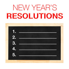New year 's Resolutions : Goals List on Blackboard with white ba